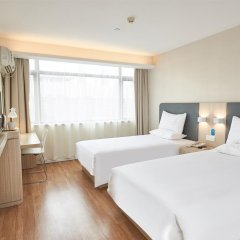 Отель Hanting Hotel Shenzhen Zhuzilin Китай, Шэньчжэнь - отзывы, цены и фото номеров - забронировать отель Hanting Hotel Shenzhen Zhuzilin онлайн комната для гостей фото 3