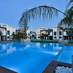 Отель OasisBeach Penthousse la Zénia бассейн