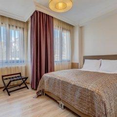 Plus Hotel Cihangir Suites Стамбул комната для гостей
