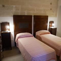 Отель Le Pietre e l'Acqua Лечче сейф в номере