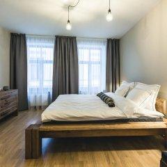 Отель Bearsleys Blacksmith Apartments Латвия, Рига - отзывы, цены и фото номеров - забронировать отель Bearsleys Blacksmith Apartments онлайн комната для гостей