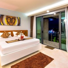 Отель At The Tree Condominium Phuket Номер Делюкс с двуспальной кроватью фото 17