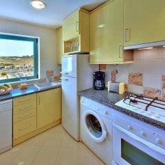 Отель Apartamentos da Marina в номере фото 2