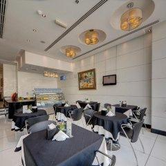 Отель Rayan Hotel Corniche ОАЭ, Шарджа - отзывы, цены и фото номеров - забронировать отель Rayan Hotel Corniche онлайн питание фото 2
