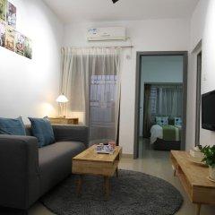 Апартаменты Shenzhen Wozhan Apartment K K Mall комната для гостей фото 4