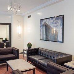 Отель Global Luxury Suites at Olympia House интерьер отеля