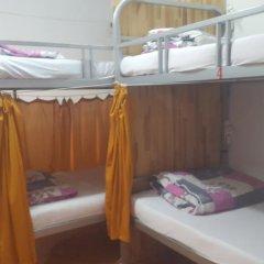 Отель Tiny Tigers Кровать в общем номере фото 6