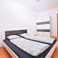 Апартаменты Corvin Apartment Budapest комната для гостей фото 2