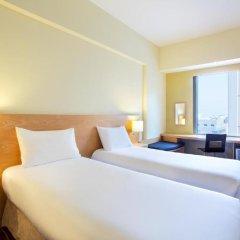Отель ibis Al Rigga 3* Стандартный номер с различными типами кроватей фото 4