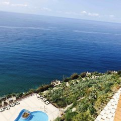 Отель Luxury Apt in Konak Sea Side with a Sea front view and a private beach пляж