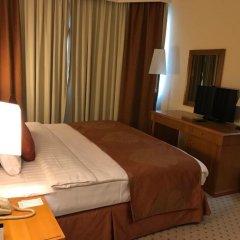Отель Golden Tulip Sharjah Апартаменты Премиум с различными типами кроватей фото 3