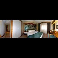 Отель Bella Стандартный номер с двуспальной кроватью фото 6