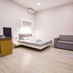 Апартаменты Pushkinskaya Apartments Харьков комната для гостей фото 2