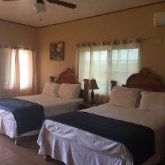 Отель Brytan Villa Ямайка, Треже-Бич - отзывы, цены и фото номеров - забронировать отель Brytan Villa онлайн комната для гостей фото 2