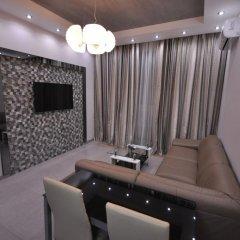 Апартаменты Греческие Апартаменты комната для гостей фото 4