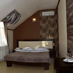 Гостиница Ростов Улучшенный номер двуспальная кровать фото 3