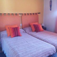 Отель La Casa del Mundo комната для гостей фото 2
