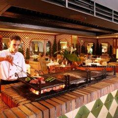 Отель Aparthotel Guitart Central Park Aqua Resort Испания, Льорет-де-Мар - отзывы, цены и фото номеров - забронировать отель Aparthotel Guitart Central Park Aqua Resort онлайн питание