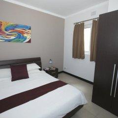 Отель Best Of Xlendi Apartments Мальта, Мунксар - отзывы, цены и фото номеров - забронировать отель Best Of Xlendi Apartments онлайн комната для гостей фото 4