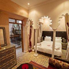 Отель Dar Ikalimo Marrakech 3* Улучшенный номер с двуспальной кроватью фото 6
