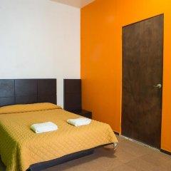 Отель Hostal Amigo Suites Кровать в женском общем номере