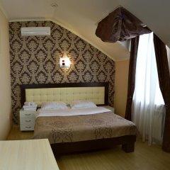 Гостиница Ростов Улучшенный номер двуспальная кровать