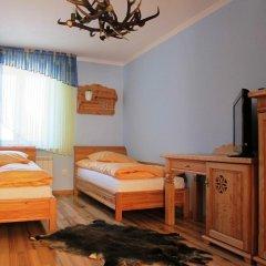 Отель udanypobyt Apartament Myśliwski Косцелиско удобства в номере