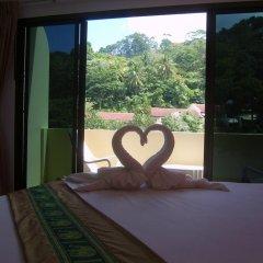 Отель Patong Bay Guesthouse 2* Улучшенный номер с различными типами кроватей фото 2