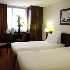 Отель Hôtel Concorde Montparnasse 4* Улучшенный номер с различными типами кроватей фото 3