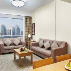 Отель Golden Tulip Sharjah Представительский люкс с различными типами кроватей фото 6