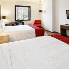 Отель Holiday Inn Express Guadalajara Autonoma 2* Улучшенный номер с различными типами кроватей фото 3