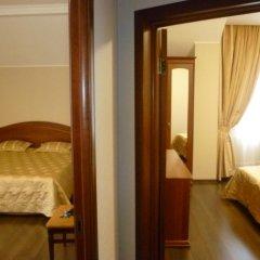 Гостиница Верона Стандартный семейный номер с разными типами кроватей фото 7