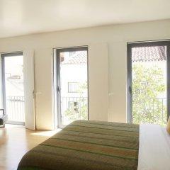 Отель Orange 3 House - Chiado Bed & Breakfast & Suites Португалия, Лиссабон - отзывы, цены и фото номеров - забронировать отель Orange 3 House - Chiado Bed & Breakfast & Suites онлайн комната для гостей