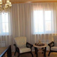 Гостиница Сафари Улучшенный семейный номер с разными типами кроватей
