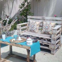 Отель Maison Tiare' Maldives Thulusdhoo Остров Гасфинолу питание