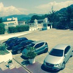 Отель Merlin Park Resort Тирана парковка