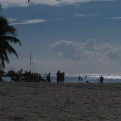 Отель Aparta Hotel Vista Tropical Доминикана, Бока Чика - отзывы, цены и фото номеров - забронировать отель Aparta Hotel Vista Tropical онлайн пляж фото 2