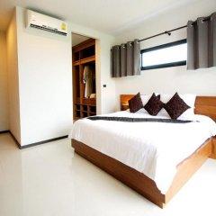 Отель Charming Pool Villa сейф в номере