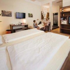 Hotel Rathaus - Wein & Design 4* Стандартный семейный номер с различными типами кроватей фото 3