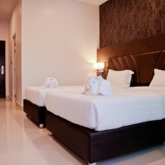 Отель 101 Holiday Suites 4* Улучшенный номер разные типы кроватей фото 4