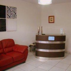 Отель Apartahotel Las Hortensias Гондурас, Тегусигальпа - отзывы, цены и фото номеров - забронировать отель Apartahotel Las Hortensias онлайн интерьер отеля