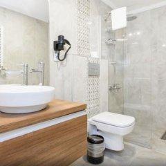 Отель Defne Suites Представительский люкс с различными типами кроватей фото 19