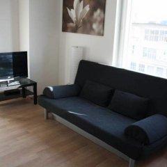 Апартаменты Letzigrund Apartments комната для гостей фото 2
