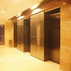 Отель Guangzhou HipHop Apartment Poly World Trade Branch Китай, Гуанчжоу - отзывы, цены и фото номеров - забронировать отель Guangzhou HipHop Apartment Poly World Trade Branch онлайн интерьер отеля