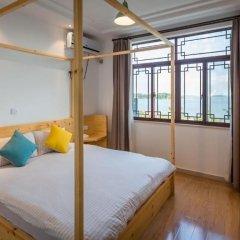 Отель Sanshan Wuli Boutique Homestay Стандартный номер с различными типами кроватей фото 9