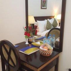 Отель Al Hayat Hotel Apartments ОАЭ, Шарджа - отзывы, цены и фото номеров - забронировать отель Al Hayat Hotel Apartments онлайн удобства в номере фото 2