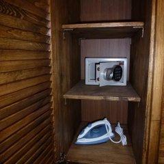 Апартаменты Private Premium Apartments сейф в номере