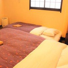 Отель K's House Tokyo Oasis Кровать в общем номере фото 5