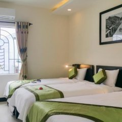 Отель Starfruit Homestay Hoi An 2* Стандартный семейный номер с двуспальной кроватью фото 14