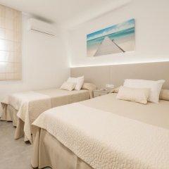 Отель Hostal El Romerito Стандартный семейный номер с двуспальной кроватью